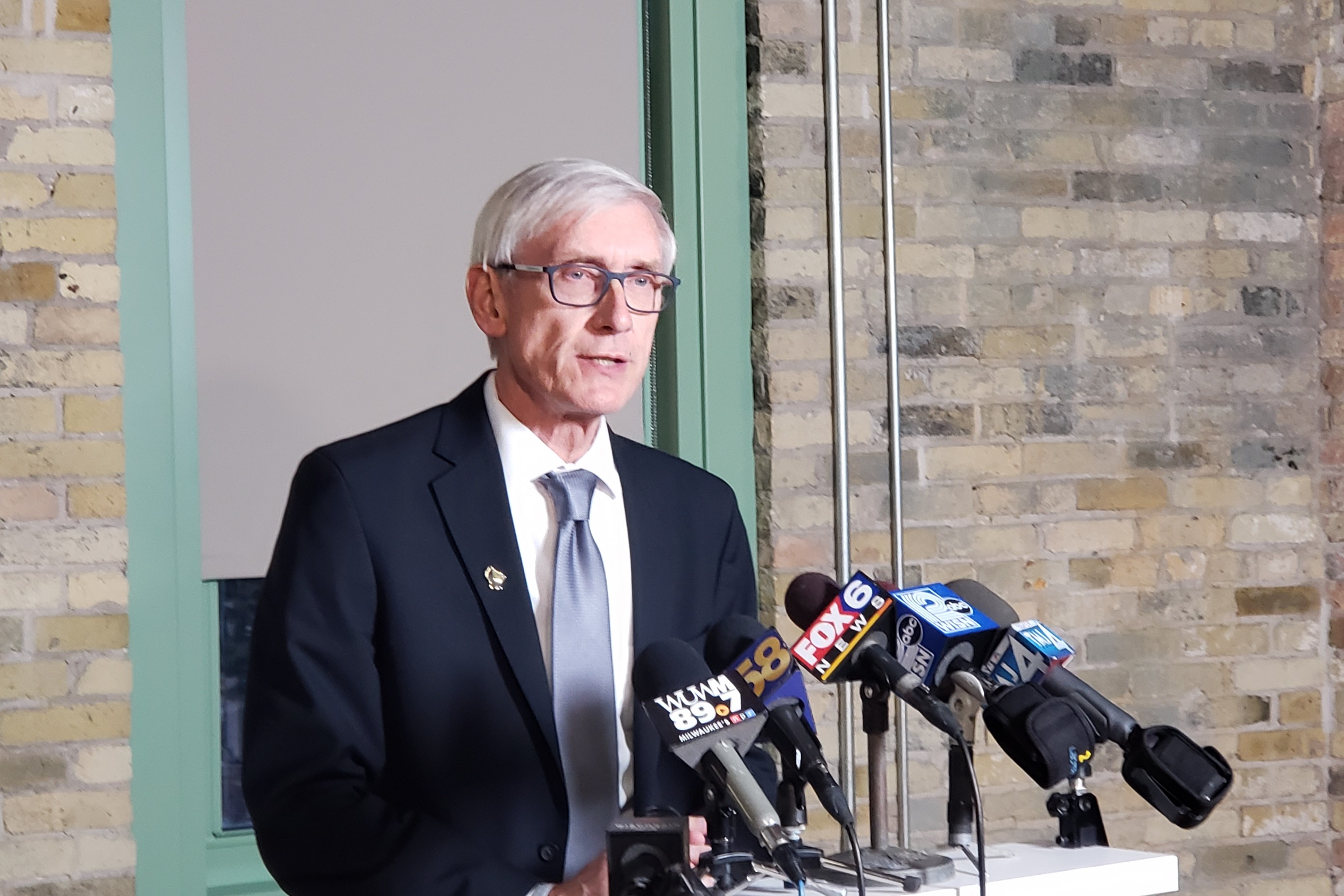 Image result for PHOTOS OF Josh Kaul TONY EVERS